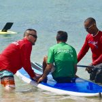 Lear how to Stand UP paddle while volunteering with travel2change