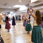 women dancing in traditional skirts